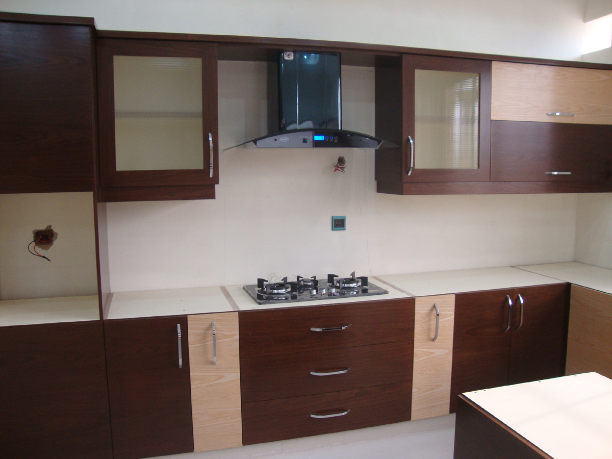 Kitchen and wardrobes with door project at islamabad dha for Kitchen wardrobe